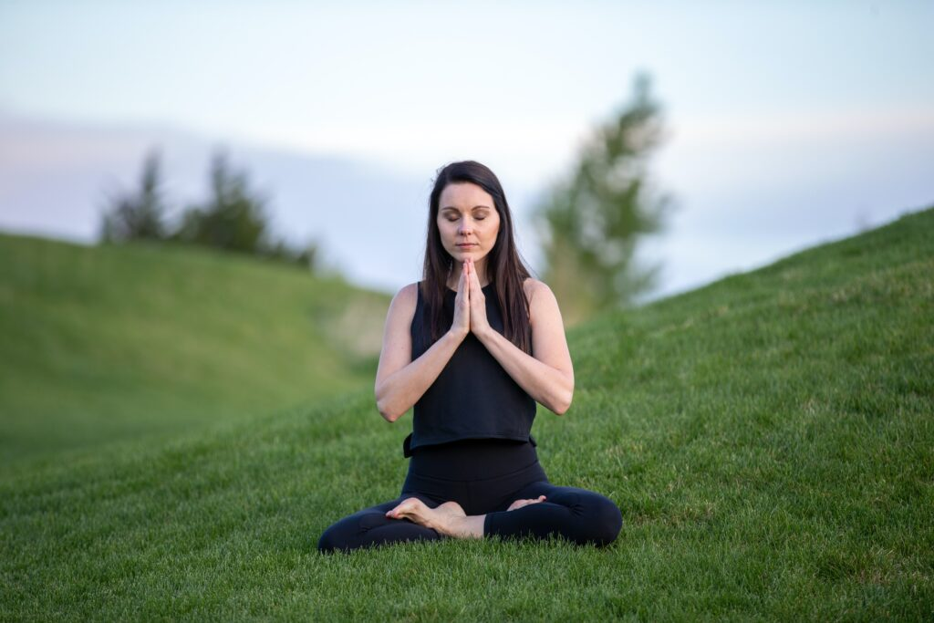 image of a woman doing meditation for emotional intelligence.